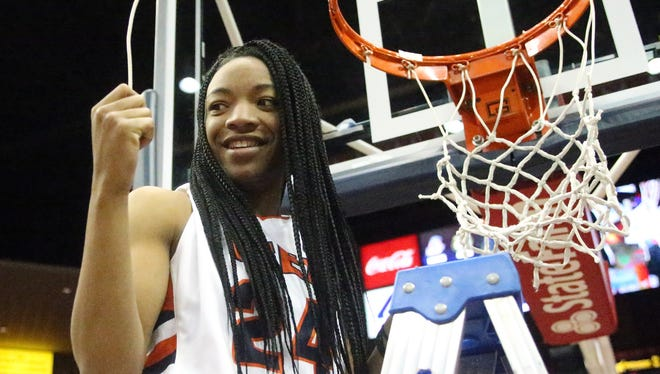 UTEP's Jenzel Nash cuts a piece of the net off the rim as the Miners celebrate their regular season Conference USA title last year in the Don Haskins Center.