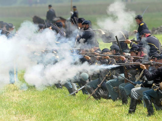 """Union action on the battlefield during the first re-enactment, """"The Devils to Pay"""" at the Gettysburg Anniversary Committee re-enactment in Gettysburg in 2013."""