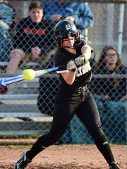 Applying bat to ball Wednesday is Plymouth junior Jessica Tucci.