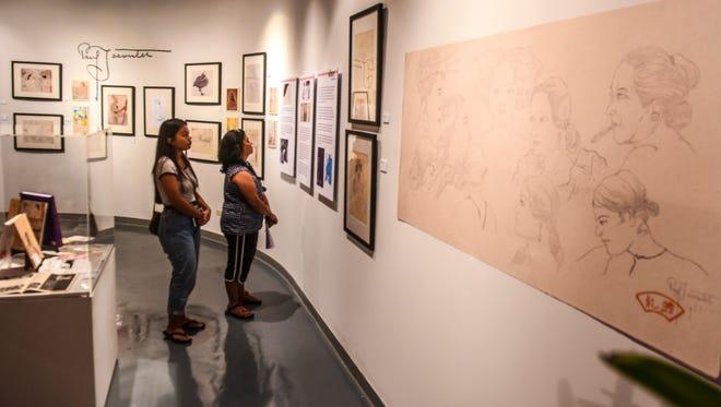 """Agana Heights residents Selencia Saladier, left, and her mother, Bertha Saladier, visit the Guam Museum during the """"Paul Jacoulet: Vision of Micronesia and Asia"""" exhibition on Friday, Nov. 10, 2017. The exhibition is slated to run from Nov. 10, 2017 through Jan. 7, 2018."""