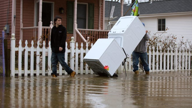 Joe Burns and his dad move appliances out of their home on Strader in the East End. Martin said so far only the basement has flooded. He's been in the home for less than two years. The Ohio River is expected to crest Tuesday at around 59 feet.