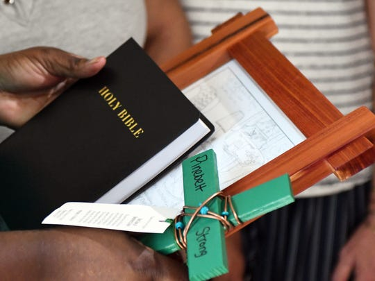 A bible and a cross were handed out.