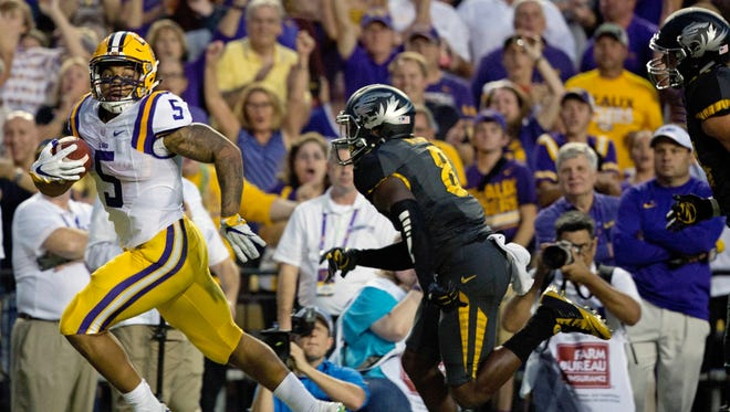 LSU running back Derrius Guice (5) runs to the end zone in front of Missouri safety Thomas Wilson (8) during the first half of an NCAA college football game in Baton Rouge, La., Saturday, Oct. 1, 2016. (AP Photo/Max Becherer)