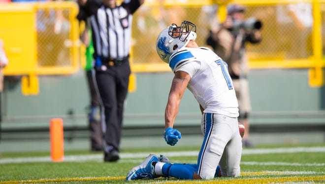 Sep 25, 2016; Green Bay, WI, USA;  Detroit Lions wide receiver Marvin Jones (11) celebrates a touchdown catch during the fourth quarter against the Green Bay Packers at Lambeau Field.  Green Bay won 34-27.  Mandatory Credit: Jeff Hanisch-USA TODAY Sports ORG XMIT: USATSI-268296 ORIG FILE ID:  20160925_jla_sh5_130.jpg