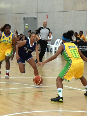 Guam national women's basketball team player Kali Benavente makes a move to the basket in their game against Solomon Islands July 8 at the Taurama Aquatics Center and Indoor Sports Complex. The basketball team won 100-72 and are now 2-2 at the 2015 Pacific Games in Port Moresby, Papua New Guinea.