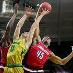Notre Dame's Rex Pflueger (0) competes for a rebound with Louisville's ChinanuOnuaku, left, and DonovanMitchell (45) during the first half of an NCAA college basketball game Saturday, Feb. 13, 2016, in South Bend, Ind. (AP Photo/Robert Franklin)