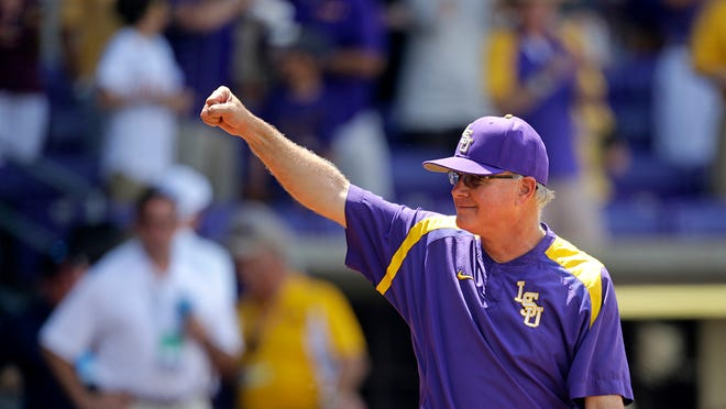 FILE - In this June 1, 2017 file photo, LSU head coach Paul Mainieri reacts to the crowd after defeating UNC Wilmington at the Baton Rouge Regional of the NCAA college baseball tournament in Baton Rouge, La. LSU is now two victories from the program's 18th trip to the College World Series in Omaha, Nebraska. Starting Saturday, June 10, the Tigers host Mississippi State in a best-of-three NCAA super regional. (AP Photo/Gerald Herbert)