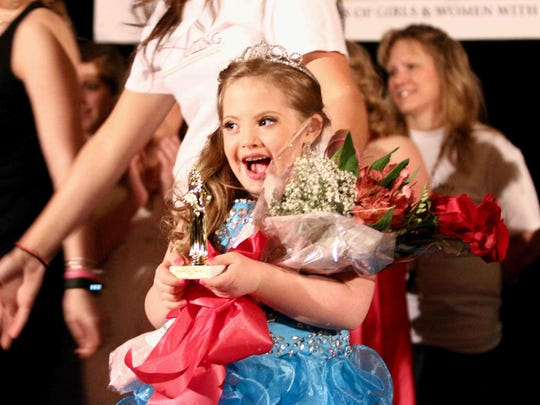 Contestant Kayla Kosmalski age 8 celebrate her Rising Star division category win in the inaugural Delaware Miss Amazing Pageant Sunday, April 12, 2015 at the Doubletree Hotel in Wilmington Delaware.