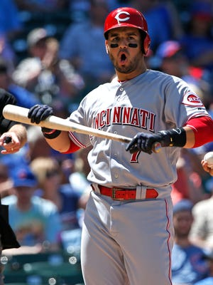 Cincinnati Reds' Eugenio Suarez reacts after striking out swinging during the fourth inning against the Chicago Cubs in Chicago Thursday.