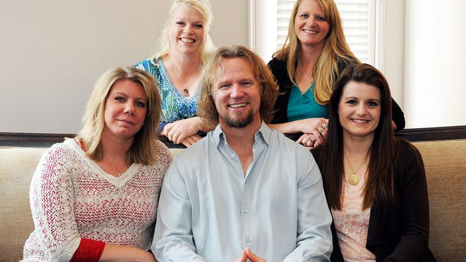 "In this July 10, 2013, file photo, Kody Brown poses with his wives at one of their homes in Las Vegas. A federal judge in Utah has issued a final ruling that strikes down parts of the state's anti-polygamy law, in a lawsuit filed by a family that appears on the TV show ""Sister Wives."" Kody Brown and his four wives sued Utah in 2011 after a county prosecutor threatened to charge them under the state's bigamy law."