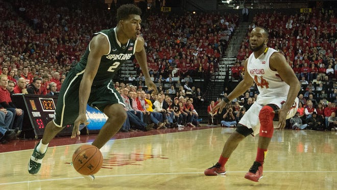 Michigan State forward Javon Bess drives to the basket as Maryland guard/forward Dez Wells defends during the second half at Xfinity Center Saturday.
