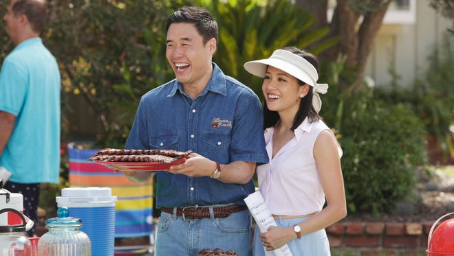 "Randall Park plays Louis Huang along with Constance Wu as his wife Jessica Huang on the new ABC television series ""Fresh Off the Boat."""