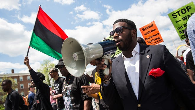 :  Protesters march from the Gilmor Homes, where Freddie Gray was arrested, to City Hall on May 2, 2015 in Baltimore for a rally.