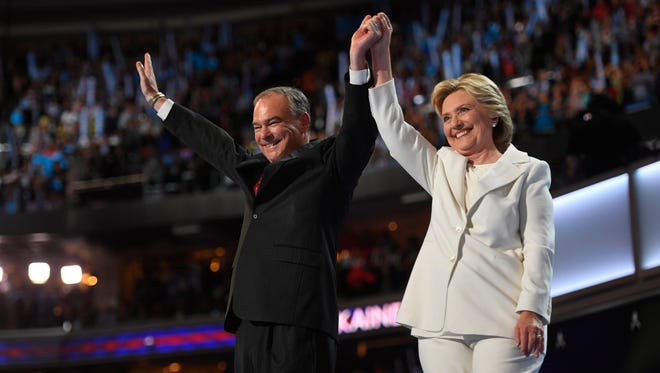 Hillary Clinton stands with her running mate, Tim Kaine, after Clinton accepted the Democratic nomination for president during the 2016 Democratic National Convention.