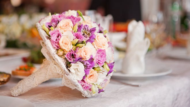 Beautiful wedding boquet lying on table.