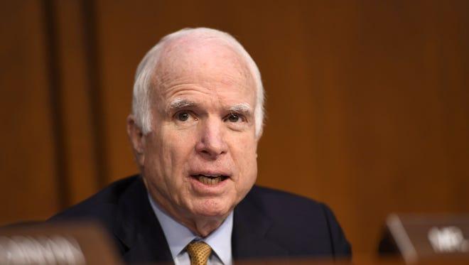 Sen. John McCain, R-Ariz., speaks as former FBI director James Comey testifies in front of the Senate Intelligence Committee in Washington.
