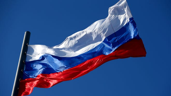 The Russian flag flaps in the wind.