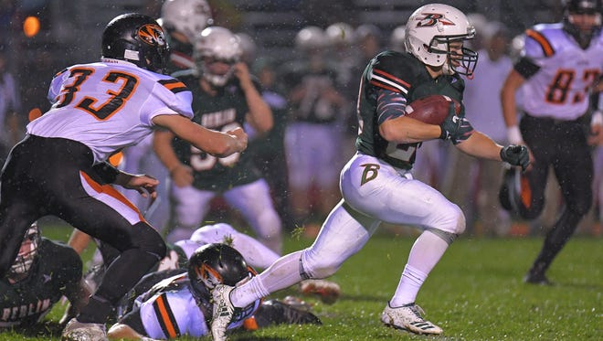 Christopher Werch (20) of Berlin breaks free for a gain. The Berlin Indians hosted the Ripon Tigers Friday evening, October 13, 2017 in an East Central Conference football matchup.