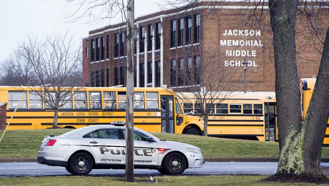 A police car is parked outside Jackson Township Middle School, Tuesday, Feb. 20, 2018 in Massillon, Ohio. A school official in Ohio says a middle school student apparently shot himself after bringing a gun to school. Police say Jackson Middle School, near Massillon, is on lockdown Tuesday and that the students and staff are safe.
