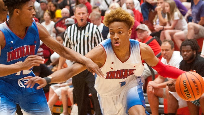 Indiana Senior All-Star Romeo Langford of New Albany H.S. (headed to Indiana) comes around Indiana Junior All Star Armaan Franklin of Cathedral H.S.June 06, 2018
