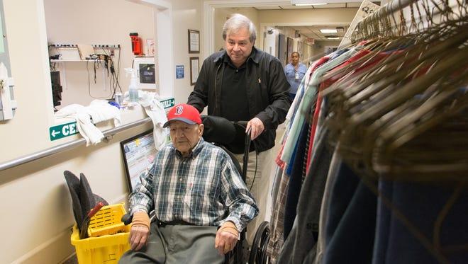 "Nick Bonanno wheels his father, World War II veteran Rosario ""Russ"" Bonanno, inside the VA nursing home in Bedford, Mass."