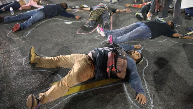 Protesters lie down in a major intersection to block traffic in Los Angeles on Nov. 24  in reaction to the Ferguson grand jury decision.