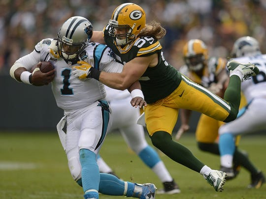 Green Bay Packers linebacker Clay Matthews (52) nearly sacks Carolina Panthers quarterback Cam Newton (1) in the third quarter of their Oct. 19 game at Lambeau Field.
