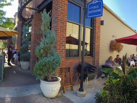 The Brighton Bar and Grill is a popular spot in downtown Brighton for outdoor dining.