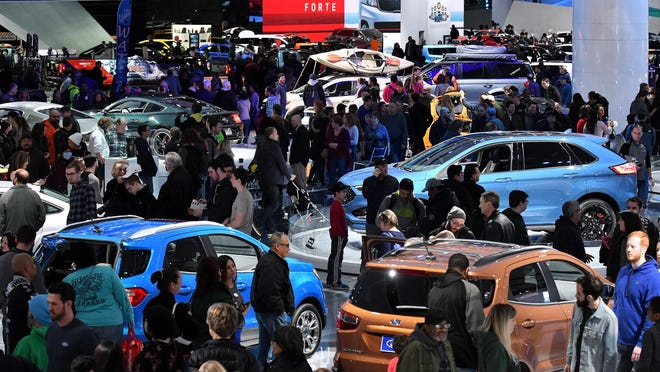 Crowds flow amongst the vehicles at the final day of the North American International Auto Show at Cobo Center in Detroit on Jan. 28, 2018. Organizers of Detroit's big auto show are talking about moving it from frigid January to October starting as early as 2020.
