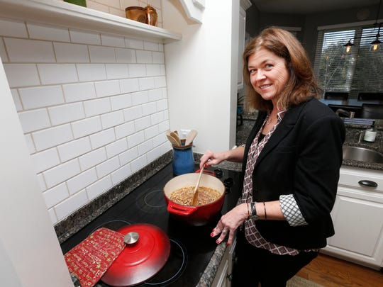 Lori Rogers simmers a pot of black-eyed peas that she