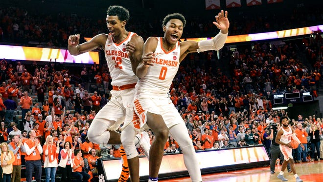Clemson forward Donte Grantham (32), left, and Clemson center Clyde Trapp (0) celebrate a 72-63 win over Miami at Littlejohn Coliseum in Clemson on Saturday.