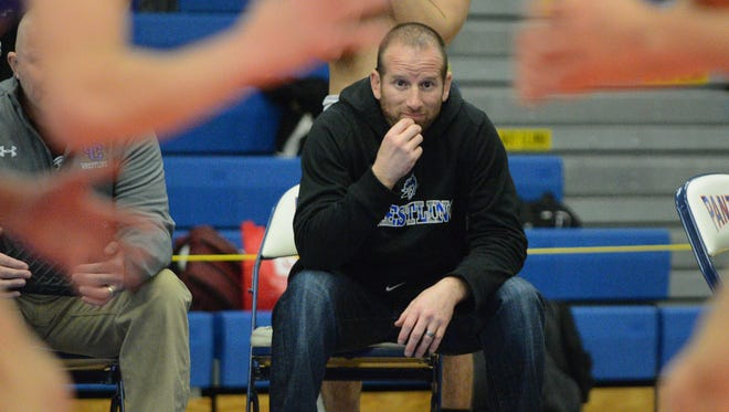 Oak Creek coach Matt Sommerville watches one of his athletes compete in a first-place match.