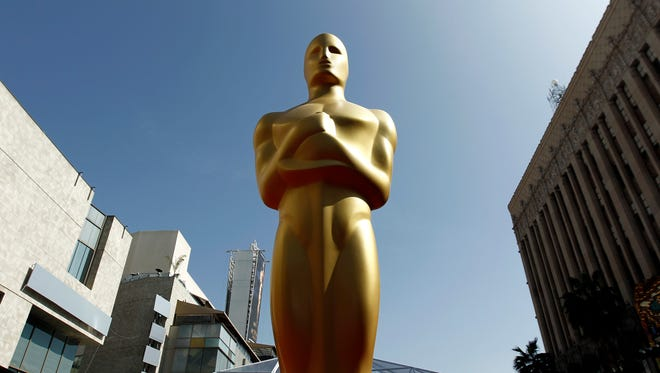 FILE - This Feb. 26, 2012 file photo shows an Oscar statue on the red carpet before the 84th Academy Awards in Los Angeles.