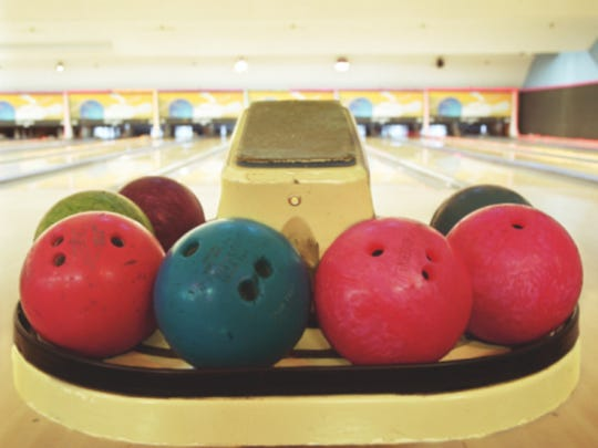 Bowling balls on ball return