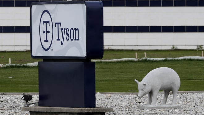 In this May 1, 2020, file photo, a sign sits in front of the Tyson Foods plant in Waterloo, Iowa. Civil rights attorney Tom Frerichs on Thursday June 25, 2020, filed a lawsuit on behalf of the estates of three Tyson Foods workers at its pork processing plant in Waterloo who died after contracting coronavirus. The lawsuit alleges the company knowingly put employees at risk during an outbreak and lied to keep them on the job.