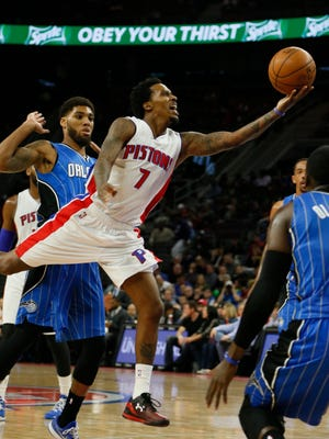 Detroit Pistons guard Brandon Jennings drives past the Orlando Magic's Devyn Marble (Southfield) for a lay-up in the second half of the Pistons' 128-118 win Wednesday, Jan. 21, 2015, in Auburn Hills.
