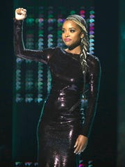 Tamika Mallory, winner of the shine a light award, appears onstage at the BET Awards.