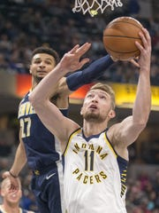 Domantas Sabonis of Indiana is defended by Jamal Murray