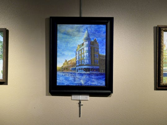 People check out Lebanon Picture Frame & Fine Art in the inagural juried exhibition: Paint the Town on Friday, April 3, 2015.  Jeremy Long -- Lebanon Daily News