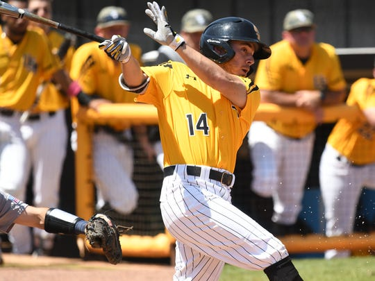 Southern Miss' Gabe Montenegro swings at a pitch against Rice Sunday.