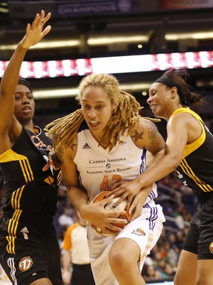 Phoenix Mercury center Brittney Griner (42) splits the Tulsa Shock defense in a recent game.  A Superior Court rejected Brittney Griner's ex-wife's request for spousal support.