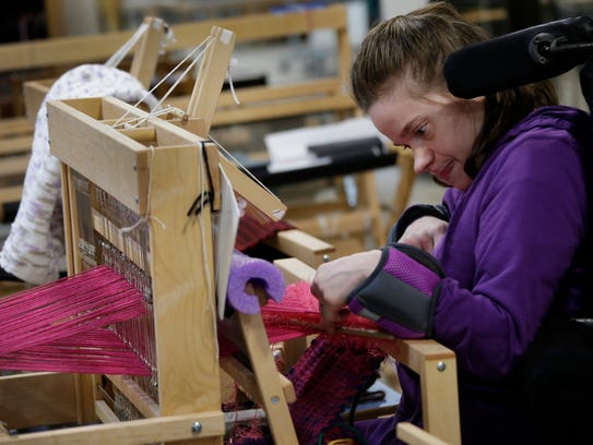 Felicia Bowers, 26, of West Bloomfield works on a loom