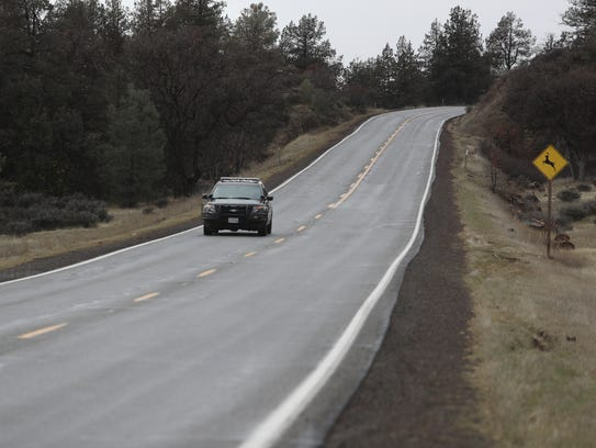 Shasta County Sheriff's Deputy Chris Wright patrols along Highway 299 east of Fall River Mills on Monday.