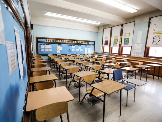 A classroom with 46 desks is filled to capacity at