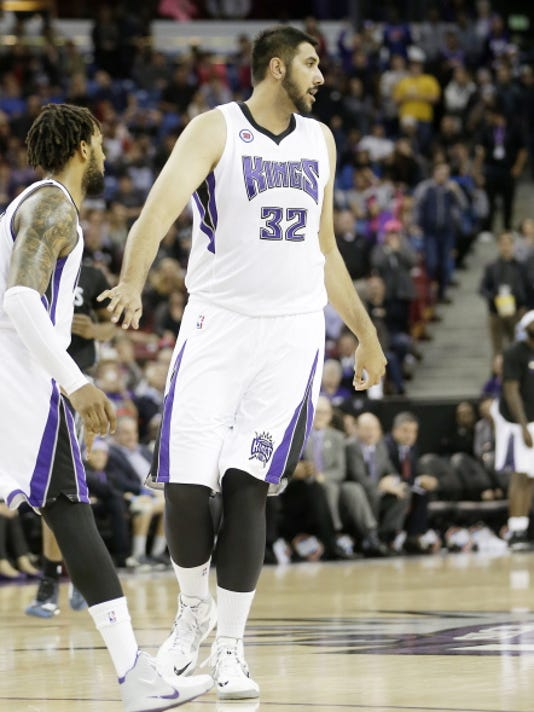 Sacramento Kings center and former New Mexico State star, Sim Bhullar, walks down the court during the closing moments of the Kings' 116-111 win over the Minnesota Timberwolves during an NBA basketball game in Sacramento, Calif., Tuesday.
