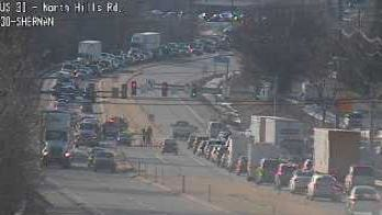 A crash blocks a lane of Route 30 east at Sherman Street on Tuesday.