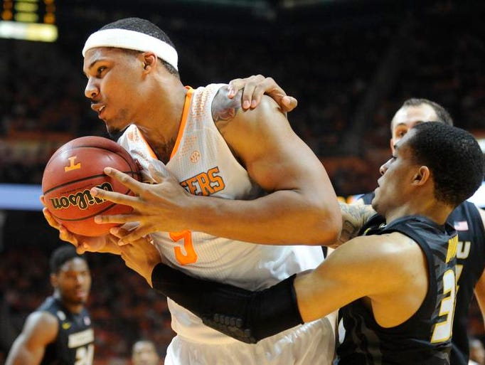 Tennessee forward Jarnell Stokes (5) muscles a rebound away from Missouri guard Jabari Brown (32) during the first half of an NCAA basketball game at Thompson-Boling Arena in Knoxville, Tenn., on Saturday, March 8, 2014. Tennessee won 72-45.