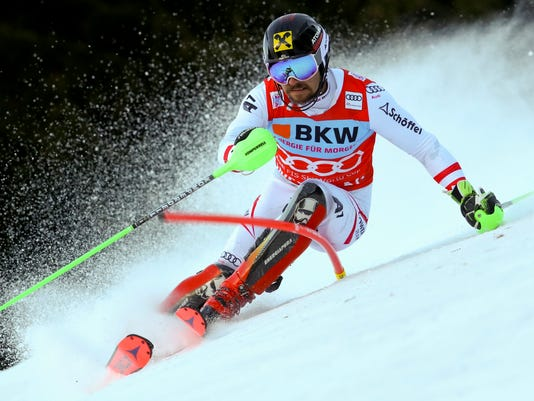 Austria's Marcel Hirscher speeds down the course during the first run of an alpine ski, men's World Cup slalom in Wengen, Switzerland, Sunday, Jan. 14, 2018. (AP Photo/Alessandro Trovati)