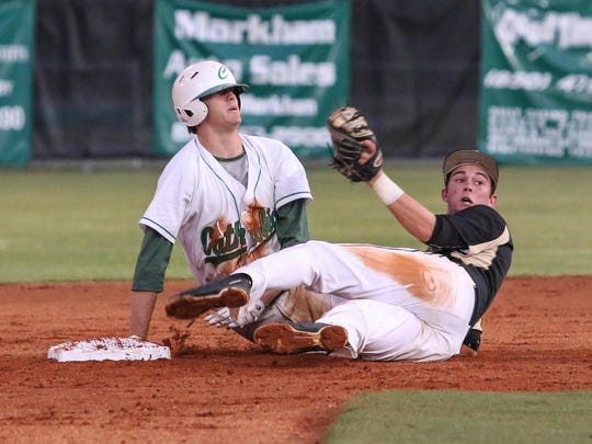 Catholic's Donovan Benoit, left, beats the throw to Providence's Alec Sanchez at second base for a double Thursday night during the Region 4A semifinal game at Catholic High School.