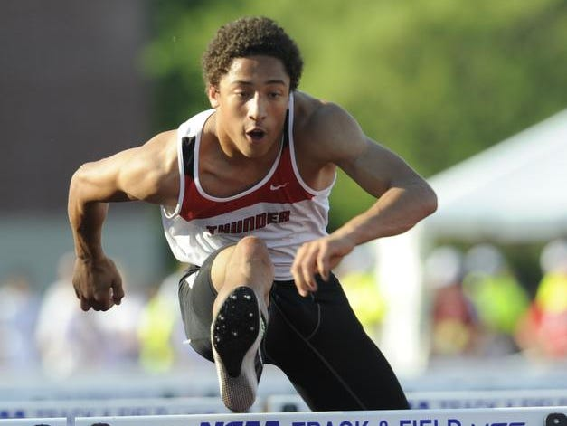 Seymour's Marcus Cornelius clears a hurdle in the boys 110 meter hurdles during the WIAA state track and field events on June 6, 2014 at the University of Wisconsin-La Crosse in La Crosse. Cornelius won conference titles Saturday in the 110-meter hurdles and the 300 hurdles at the Bay Conference championship meet in Marinette. He won the 110 in 15.12 seconds and the 300 in 41.39 seconds.
